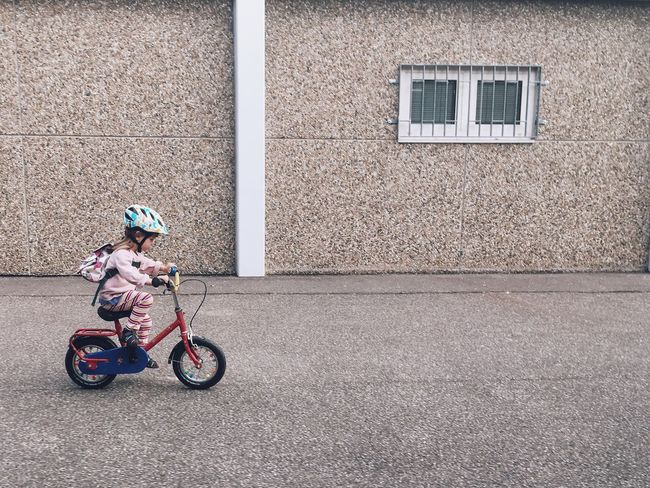Race Everyday Child Childhood Bike Kid Little Girl Strong Pace Urban City Stone Focused Ride Rider Fast