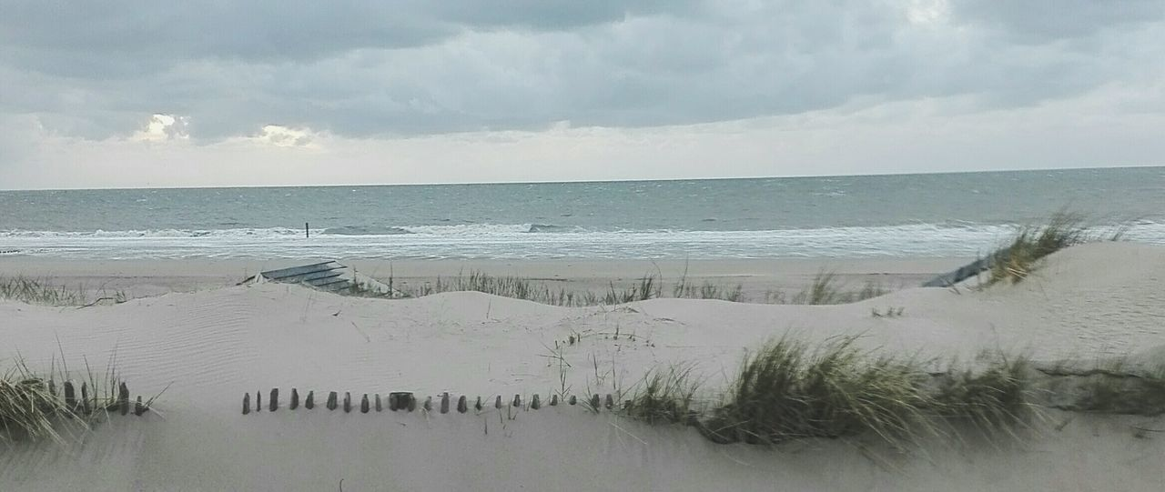 Landscape Outdoors Nature Water Beach No People Extreme Weather Day Grey Sky Rainy Days☔ Groede Netherlands Nature Beauty In Nature Horizon Over Water