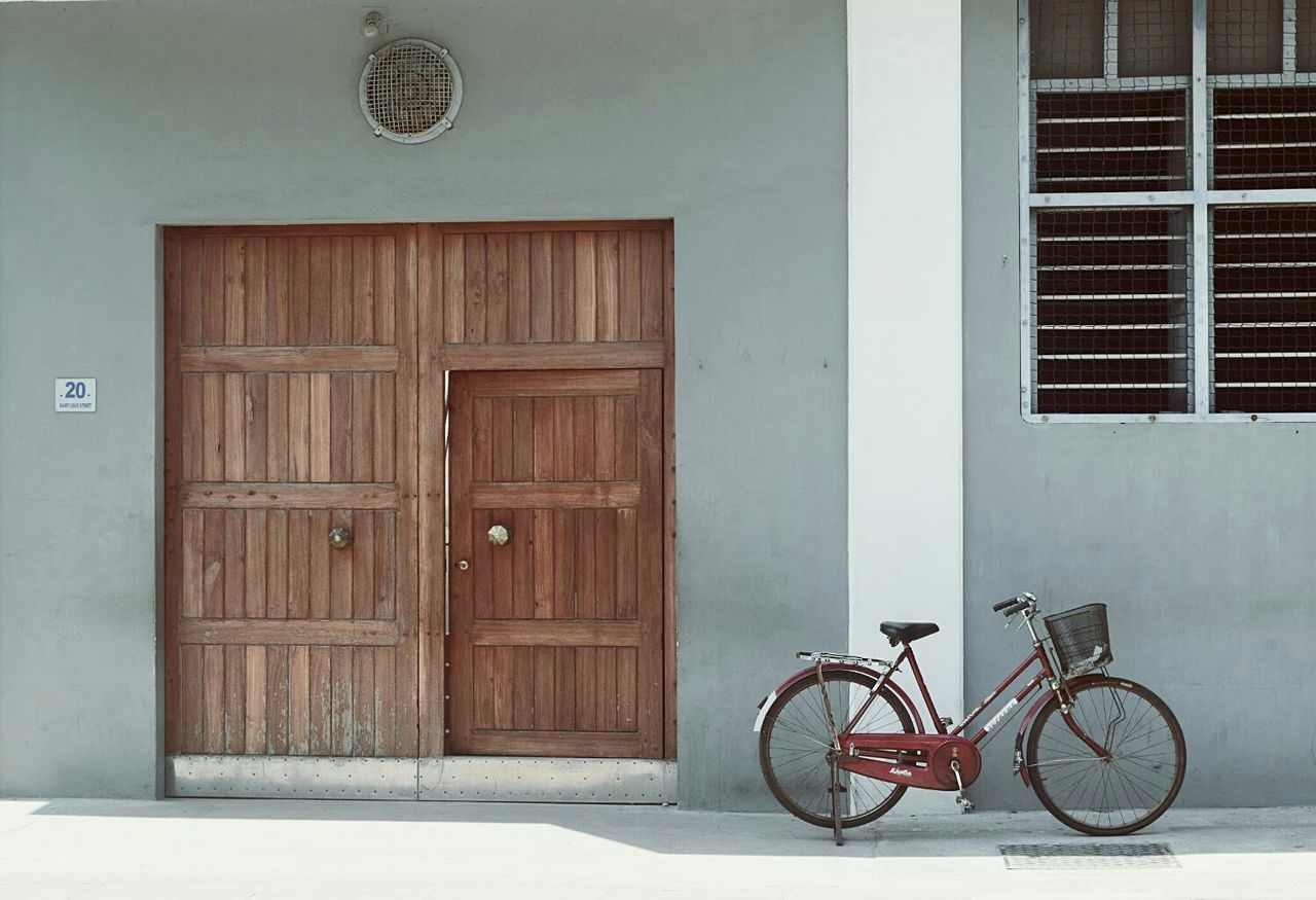 door, bicycle, safety, architecture, wood - material, transportation, built structure, mode of transport, no people, day, outdoors, building exterior