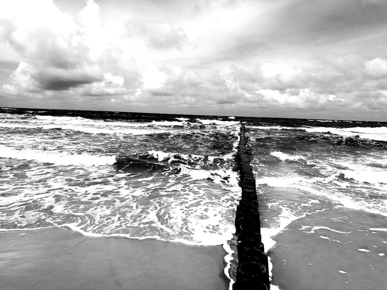 sea, water, nature, beauty in nature, wave, scenics, sky, tranquility, tranquil scene, no people, cloud - sky, outdoors, day, horizon over water, motion, beach, power in nature