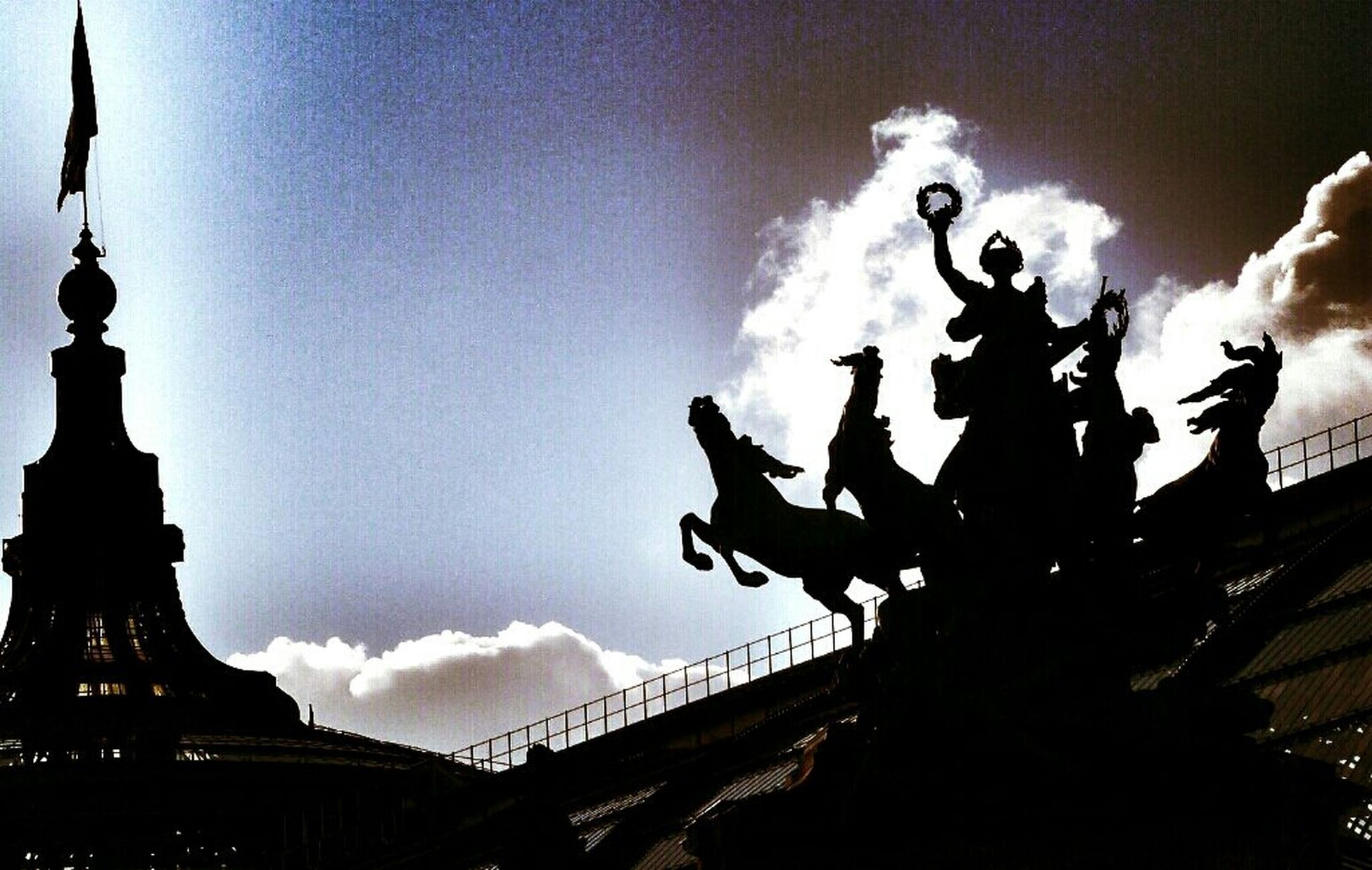 statue, sculpture, human representation, silhouette, art and craft, sky, art, low angle view, creativity, built structure, architecture, famous place, men, tourism, travel destinations, lifestyles, international landmark, sunset