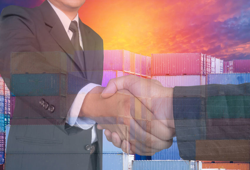 Golbal Container Ship Double Exposure Industry International Logistics Map Teamwork Transportation Business Finance And Industry Business People Carcorners Co-worker Export Greetiong Hand Handshake Human Hand Important Partnership Ship Shipping  Sky Successful