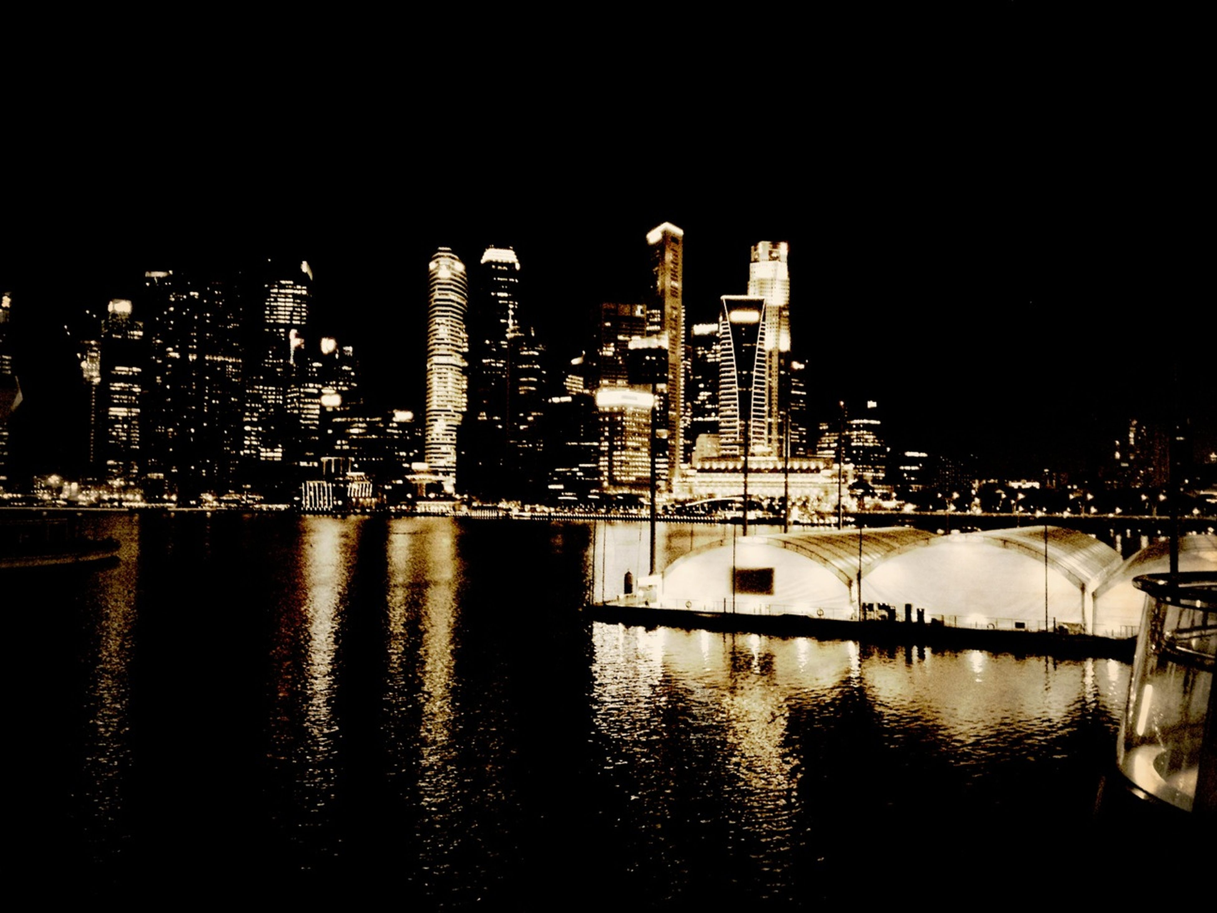 night, illuminated, water, architecture, city, building exterior, waterfront, built structure, reflection, river, cityscape, skyscraper, clear sky, modern, sea, copy space, urban skyline, no people, tower, sky