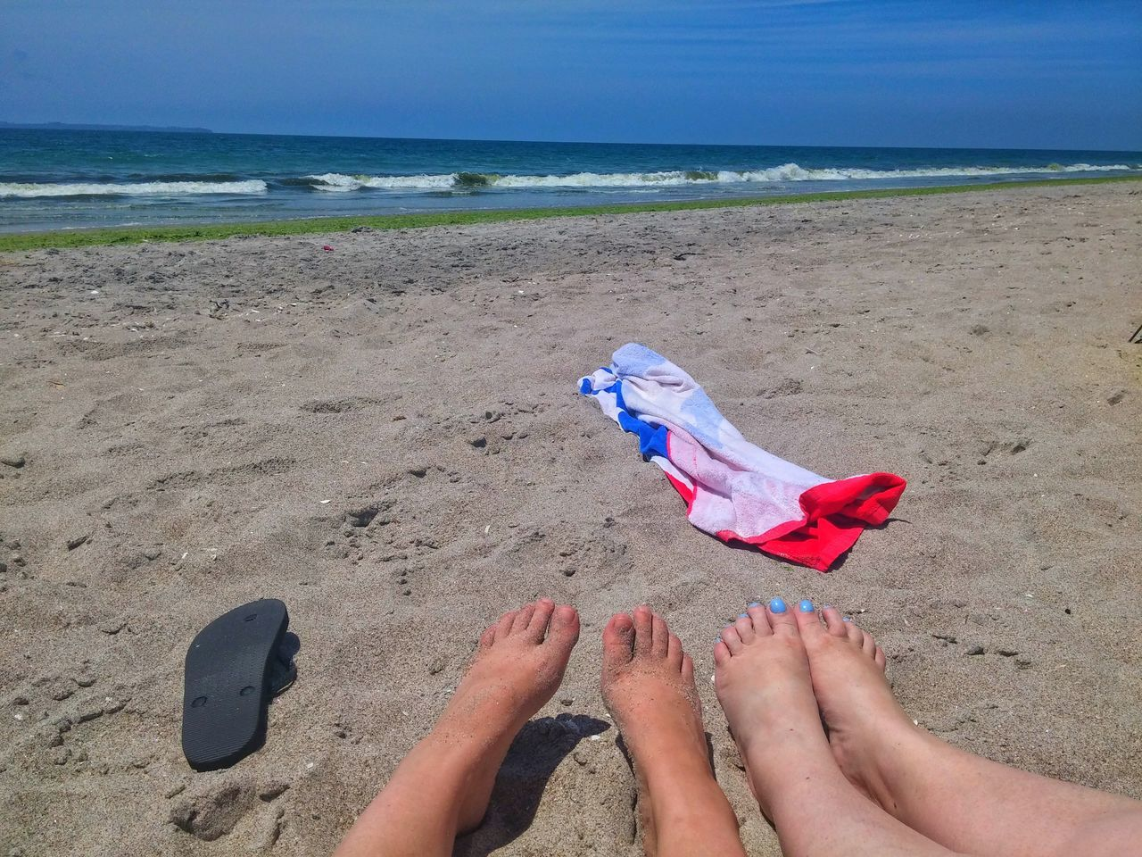 beach, sand, sea, human body part, low section, barefoot, day, horizon over water, human leg, water, outdoors, vacations, real people, nature, sky, beauty in nature, one person, people