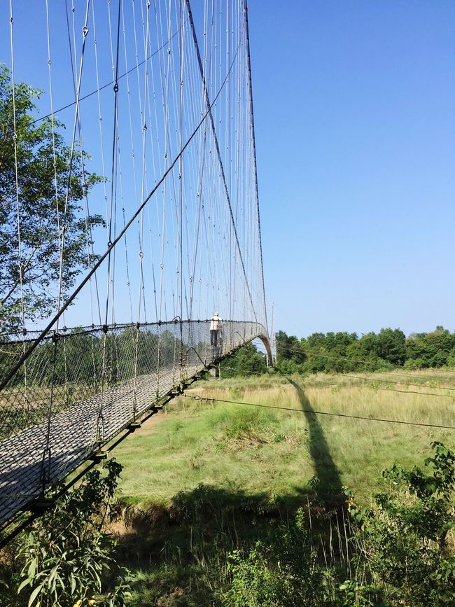 Suspension bridge on the way to village. Beautiful Nature