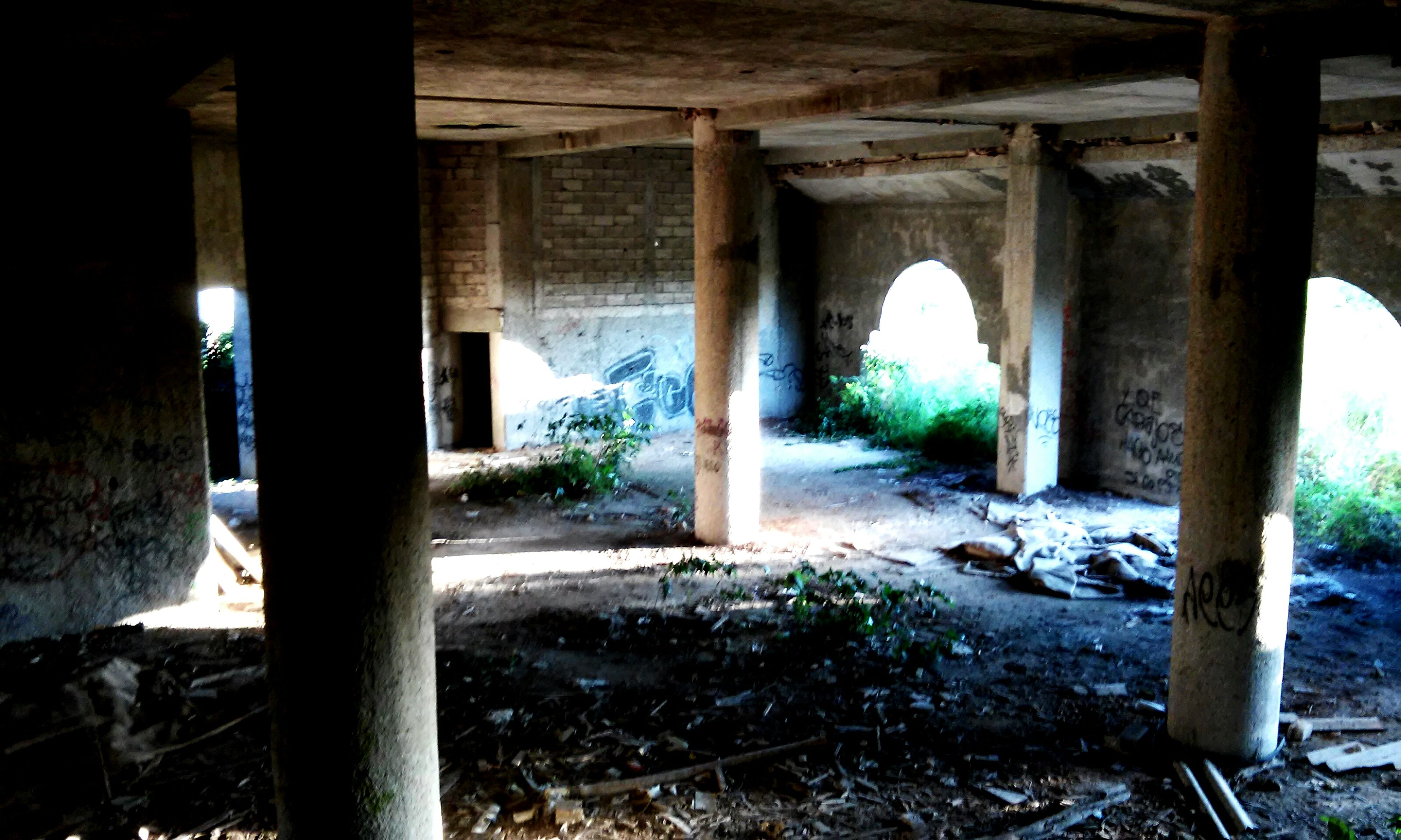 built structure, architecture, architectural column, indoors, abandoned, column, old ruin, old, obsolete, damaged, run-down, sunlight, arch, ruined, support, deterioration, history, day, no people, weathered