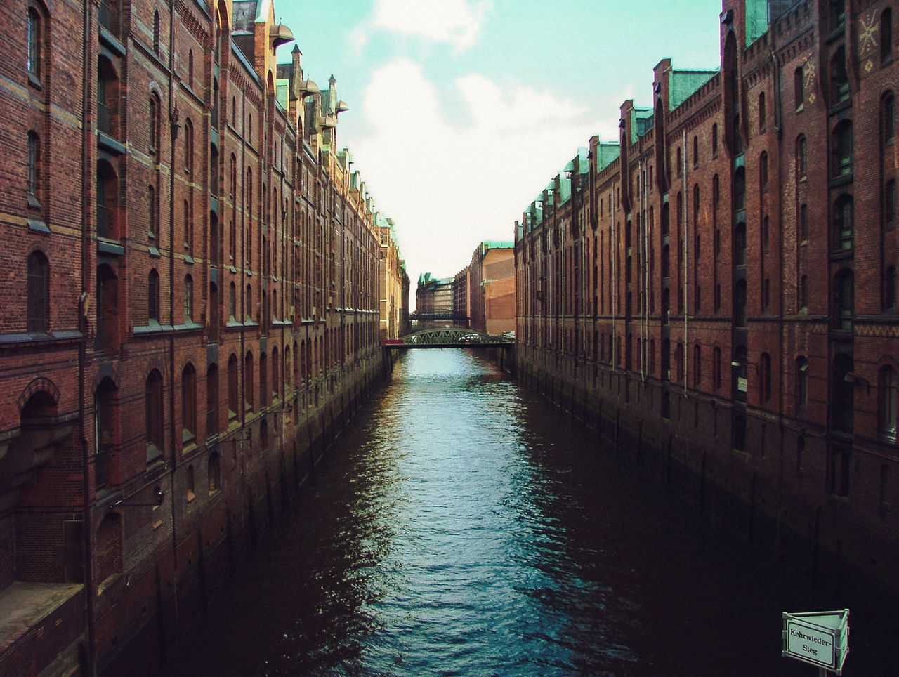 View of canal between buildings