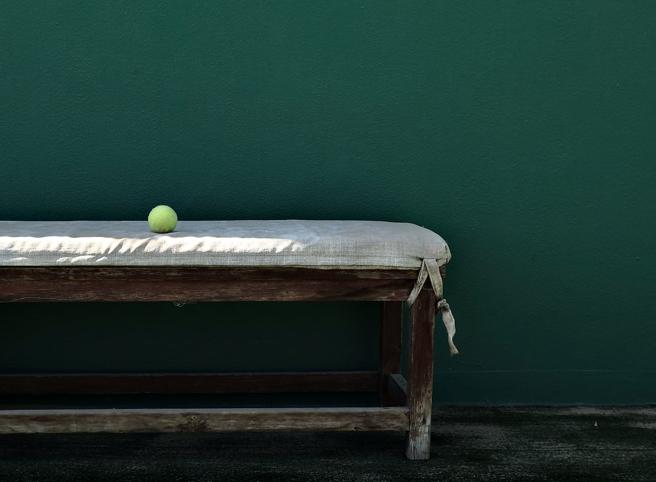 Abandoned Bench Competition Copy Space Court Green Color Green Wall High Contrast Leftbehind Light And Shadow Minimalism Muted Colors No People Racket Sport Seat Simplicity Single Tennis Ball On An Old Bench Sport Table Tennis Tennis Court