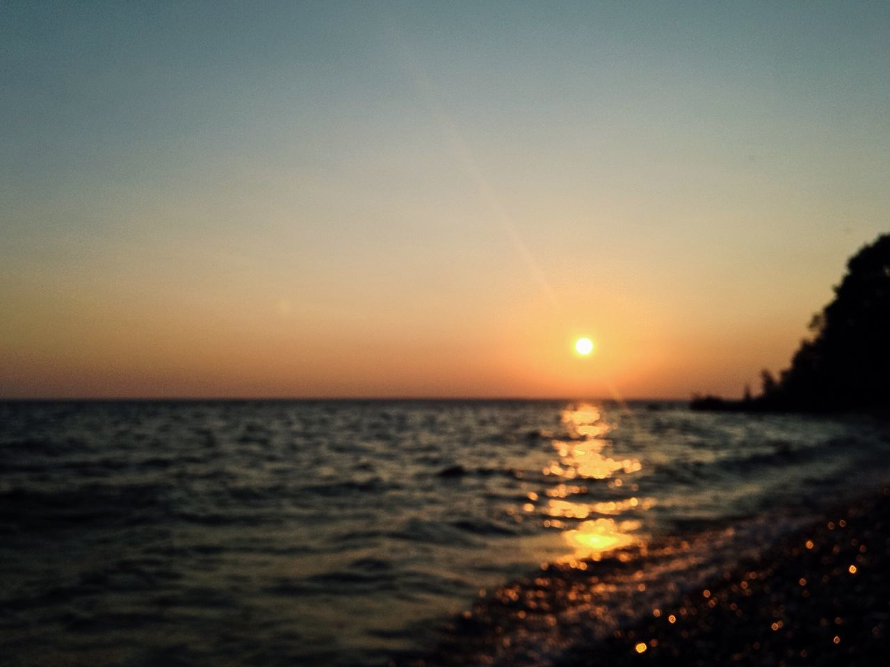 sunset, sea, sun, scenics, tranquility, nature, tranquil scene, water, beauty in nature, sky, idyllic, silhouette, no people, horizon over water, clear sky, landscape, outdoors, horizon