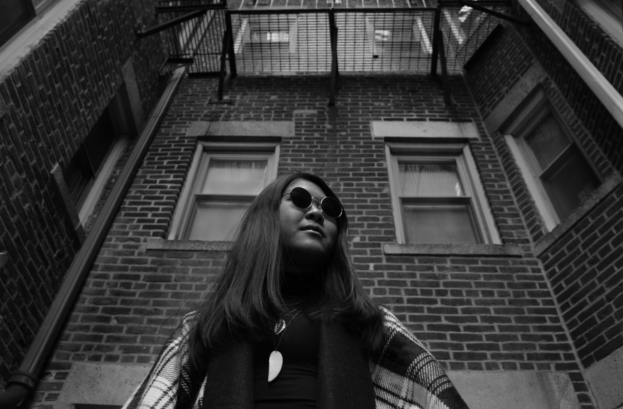 Architecture Beauty Blackandwhite Boston Building Exterior Built Structure Casual Clothing City Life Day Exploring Front View Headshot Lifestyles Long Hair Low Angle View Modern Person Portrait Standing Sunglasses Waist Up Window Young Adult Young Woman Young Women