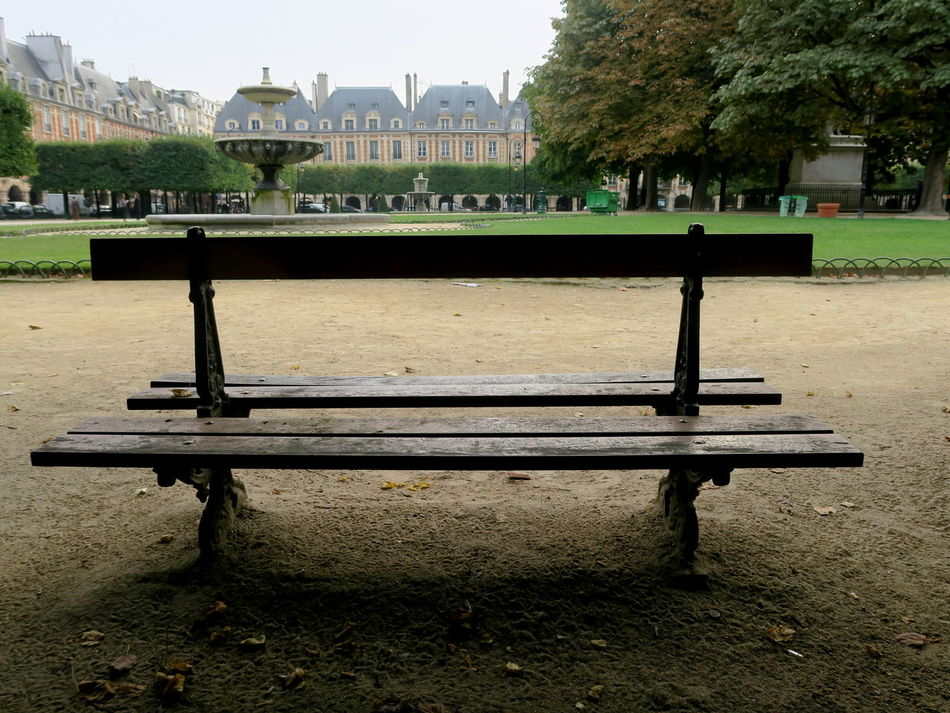Place des Vosges: on a quiet day (if there is one) Bastille Bench Benches Benches & Branches Benchinthepark Cast Iron Day Fountain Fountain_collection Fountains Ironwork  Linden Linden Tree No People Outdoors Paris Paris, France  Park Place Des Vosges Place Des Vosges, Paris, France Tree Walk In The City Walk In The Park