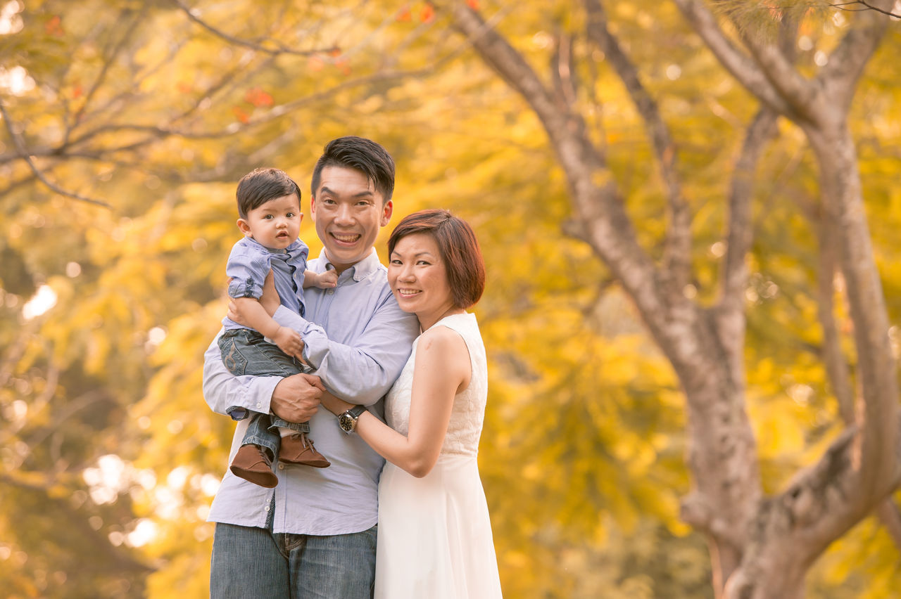 Chinese Family ASIA Asian  Asian Family Autumn Bonding Casual Clothing Change Chinese Daughter Family Family With Two Children Father Focus On Foreground Happiness Love Mid Adult Mid Adult Men Mid Adult Women Mother Nature Outdoors Son Three Quarter Length Togetherness Tree