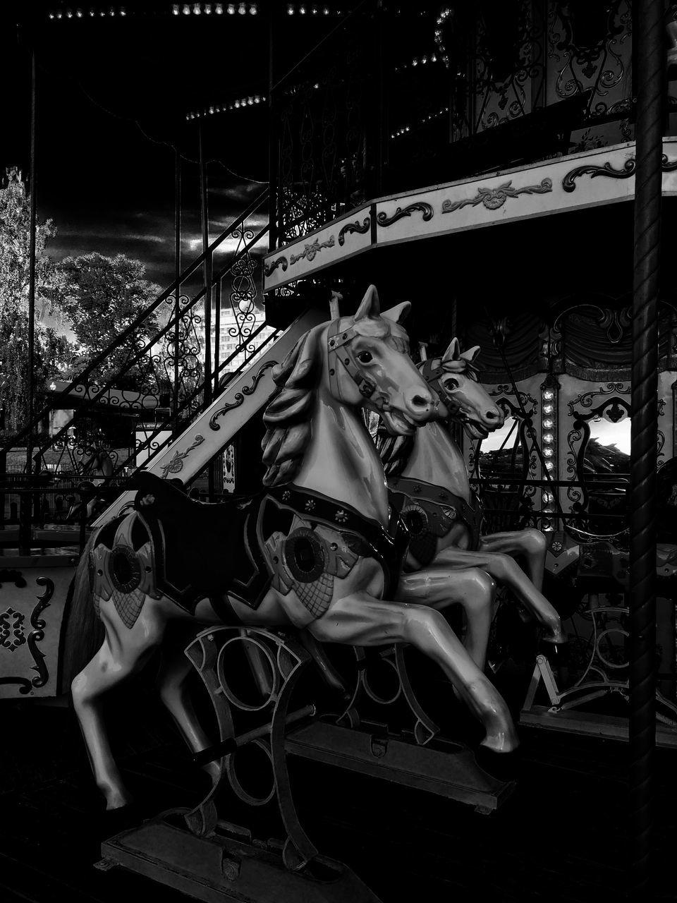 amusement park, carousel horses, amusement park ride, animal representation, horse, carousel, arts culture and entertainment, night, no people, animal themes, outdoors