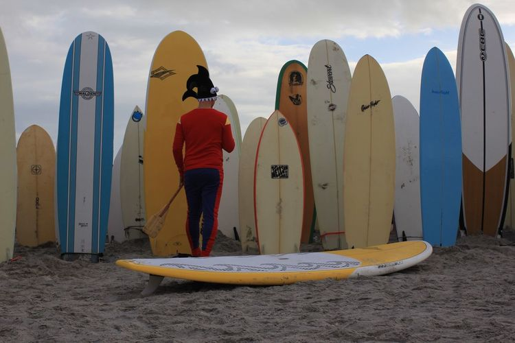 The joker Surfing Santas Cocoa Beach, Florida Surf Boards Paddle Board Joker Real People Surfboard Oar Paddle One Person Multi Colored In A Row