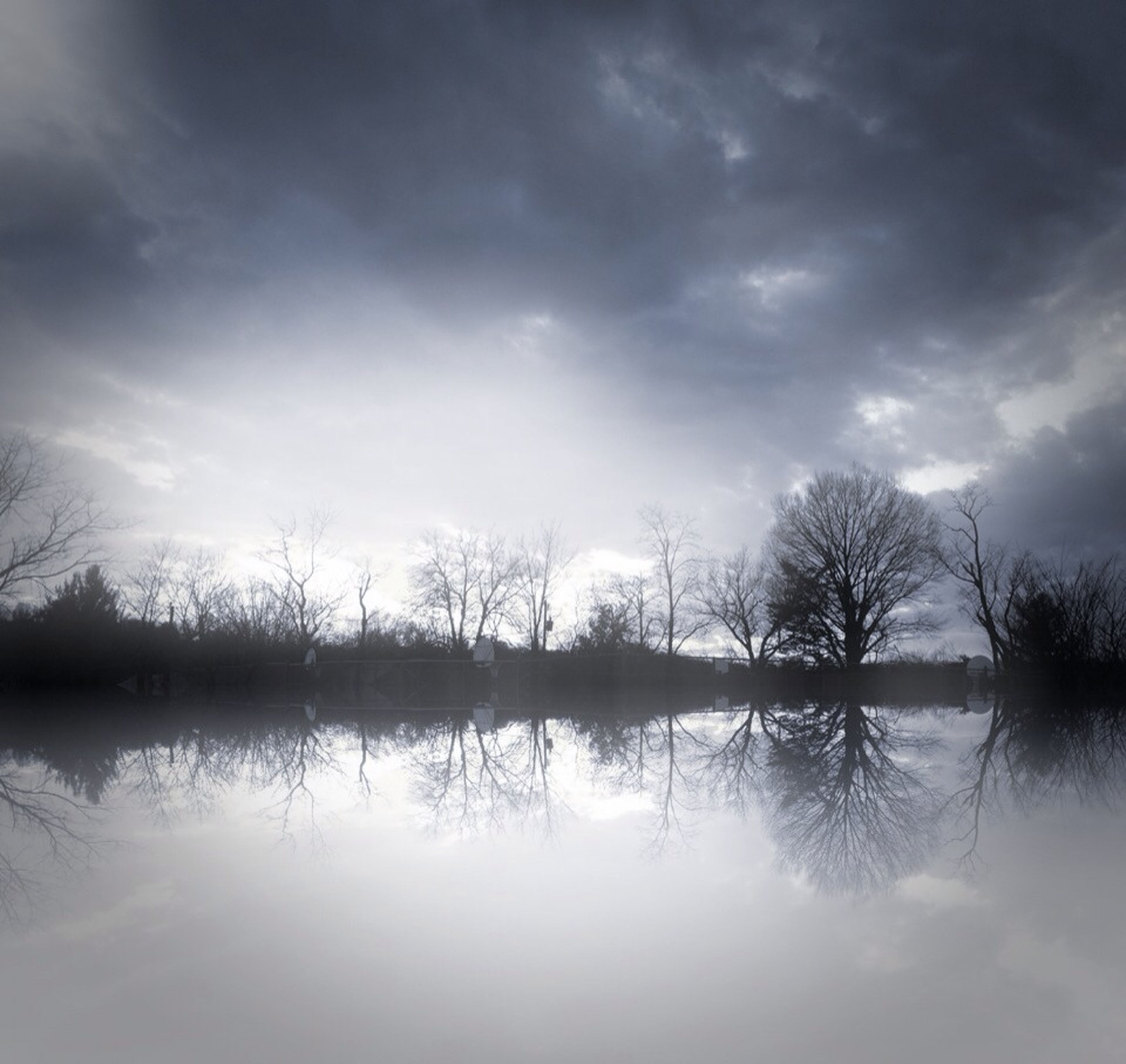 sky, water, tranquility, tranquil scene, cloud - sky, lake, tree, scenics, reflection, beauty in nature, silhouette, cloudy, nature, cloud, waterfront, bare tree, idyllic, sunset, calm, river