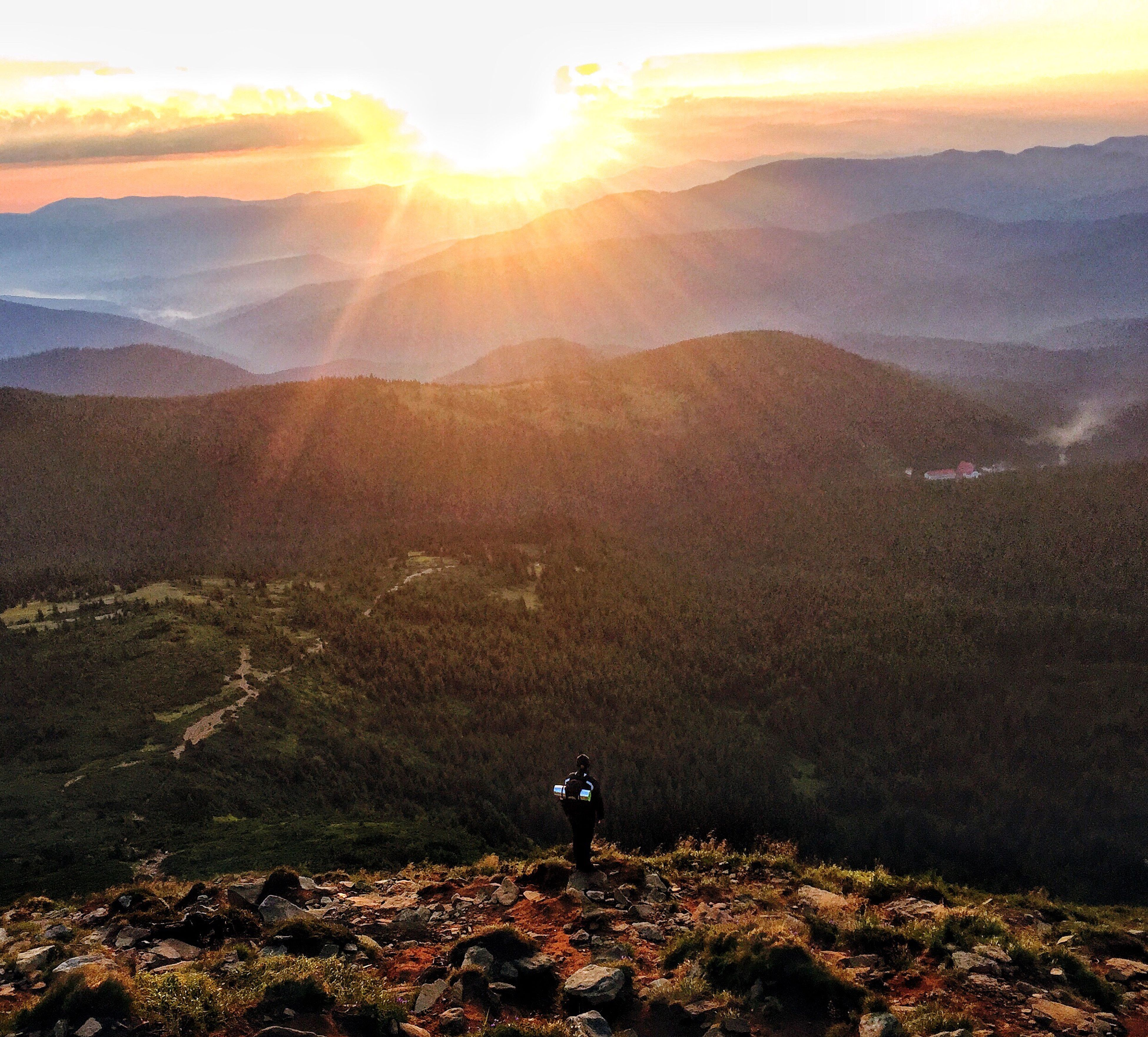 sunset, sunlight, beauty in nature, nature, sunbeam, sky, scenics, sun, outdoors, tranquility, tranquil scene, landscape, mountain, one person, day, people