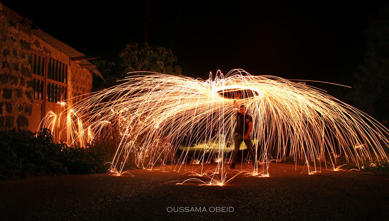 Night Long Exposure Motion Illuminated Celebration Sparks Outdoors Speed Firework - Man Made Object Firework Display Wire Wool Blurred Motion No People LiveLoveLebanon Sky Low Angle View Love EyeEm Best Shots Arabphotographers Photographer Oussamaobeid