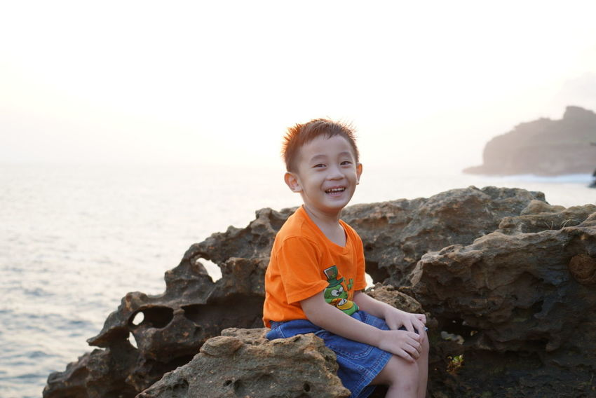 A lively smile upon a sunset Child Children Only Childhood One Boy Only Smiling Sea Beach Happiness Outdoors Portrait Sunset Pantai Timang Valiant