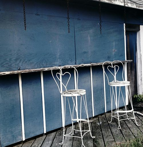 Urban Exploration By The Pool Two Chairs Heartshape Blue Wooden  Wall