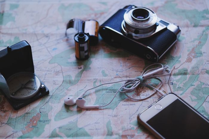 Adventure kit... Camera - Photographic Equipment Technology Navigation Map Filmcamera View From Above Photography Themes Headphones Smartphone Compass Travel Kit Hiking Technology I Can't Live Without Vscocam My Favorite Photo Found On The Roll Using Technology Details Of My Life Made In Romania Film Camera Film Roll Old Map Close Up Technology Mobile Conversations