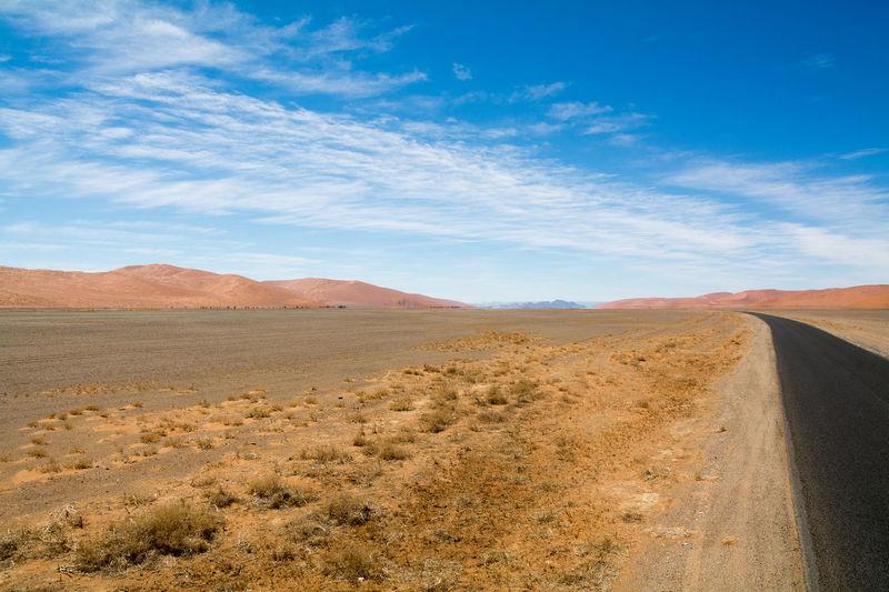 road through the sossusvlei, namibia Africa African Arid Cloud - Sky Desert EyeEm Nature Lover Landscape Landscapes Namib Naukluft National Park Namibia Namibian Nature Naukluft Road Sand Dunes Scenery Sossusvlei Sossusvlei Desert - Namibia South Africa Tared The Way Forward Tranquil Scene Transportation Travel Traveling