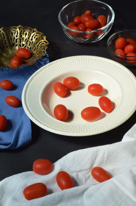 Grape tomatoes Bowl Food Food And Drink Fresh Produce Freshness Grape Tomatoes Group Of Objects Indoors  Indulgence Plate Ready-to-eat Red Tomato Tomatoes Vegetables