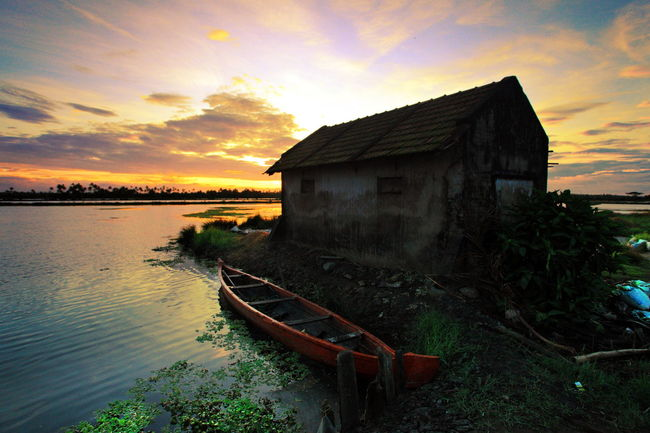 A beautiful sunrise at Kadamakkudi, Kerala. Abandoned Boat Goldernhour Goodmorning House Kerala Kochi Leading Mode Of Transport Nautical Vessel Obsolete Outdoors Residential Structure River Sunrise Water Water Reflections Waterfront