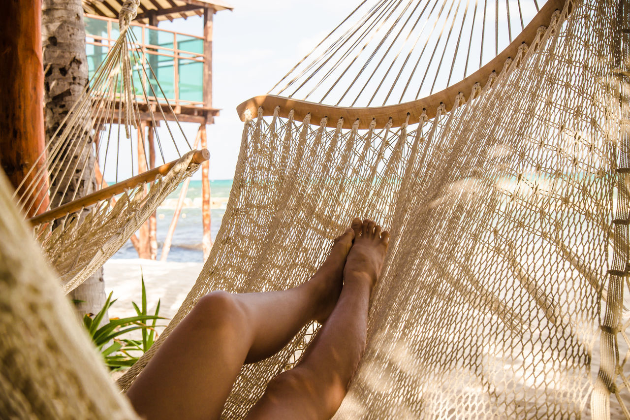 Legs of a young woman relaxing in a hammock on a beach #bare Feet #hammock #JustMe #lazyday #lazysunday #Legs #me #relax #sunset #sun #clouds #skylovers #sky #nature #beautifulinnature #naturalbeauty #photography #landscape #tropical #Vacation #wishiwashere Close-up Day One Person Outdoors People Sky Water