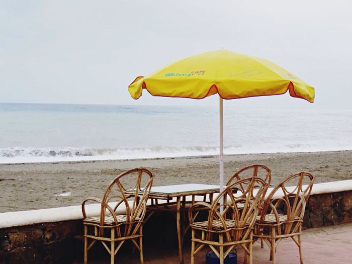 Paint The Town Yellow Beach Sea Yellow Outdoors Chair Summer No People Sky Beauty In Nature Vacations Water Horizon Over Water Nature Sand Clear Sky Day First Eyeem Photo Ouedlou