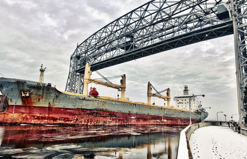 Duluth Aerial Lift Bridge. Bridge - Man Made Structure Cargo Ship Cloud - Sky Duluth Minnesota USA Low Angle View Nautical Vessel Outdoors Ship Shipping  Water Aerial Lift Bridge, Duluth EyeEmNewHere