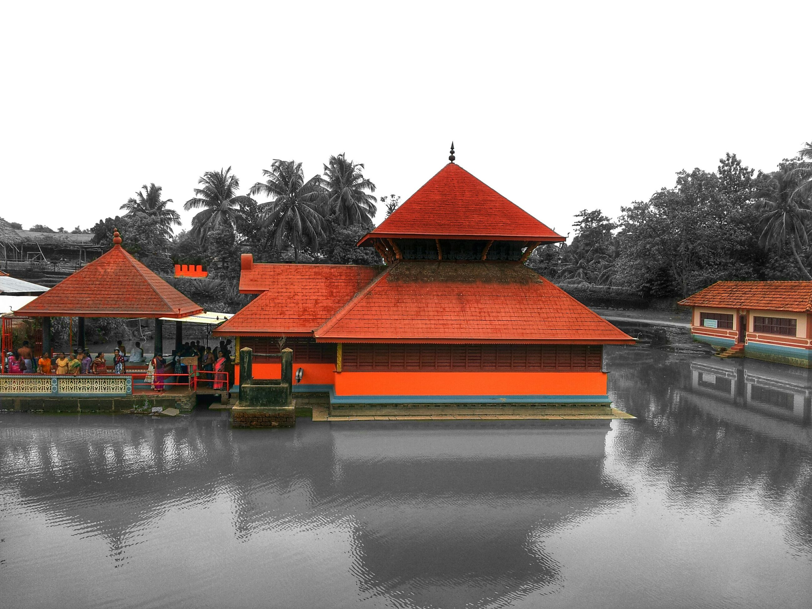 architecture, built structure, water, building exterior, waterfront, clear sky, tree, reflection, house, river, lake, canal, day, outdoors, sky, roof, gazebo, residential structure, tranquility, bridge - man made structure