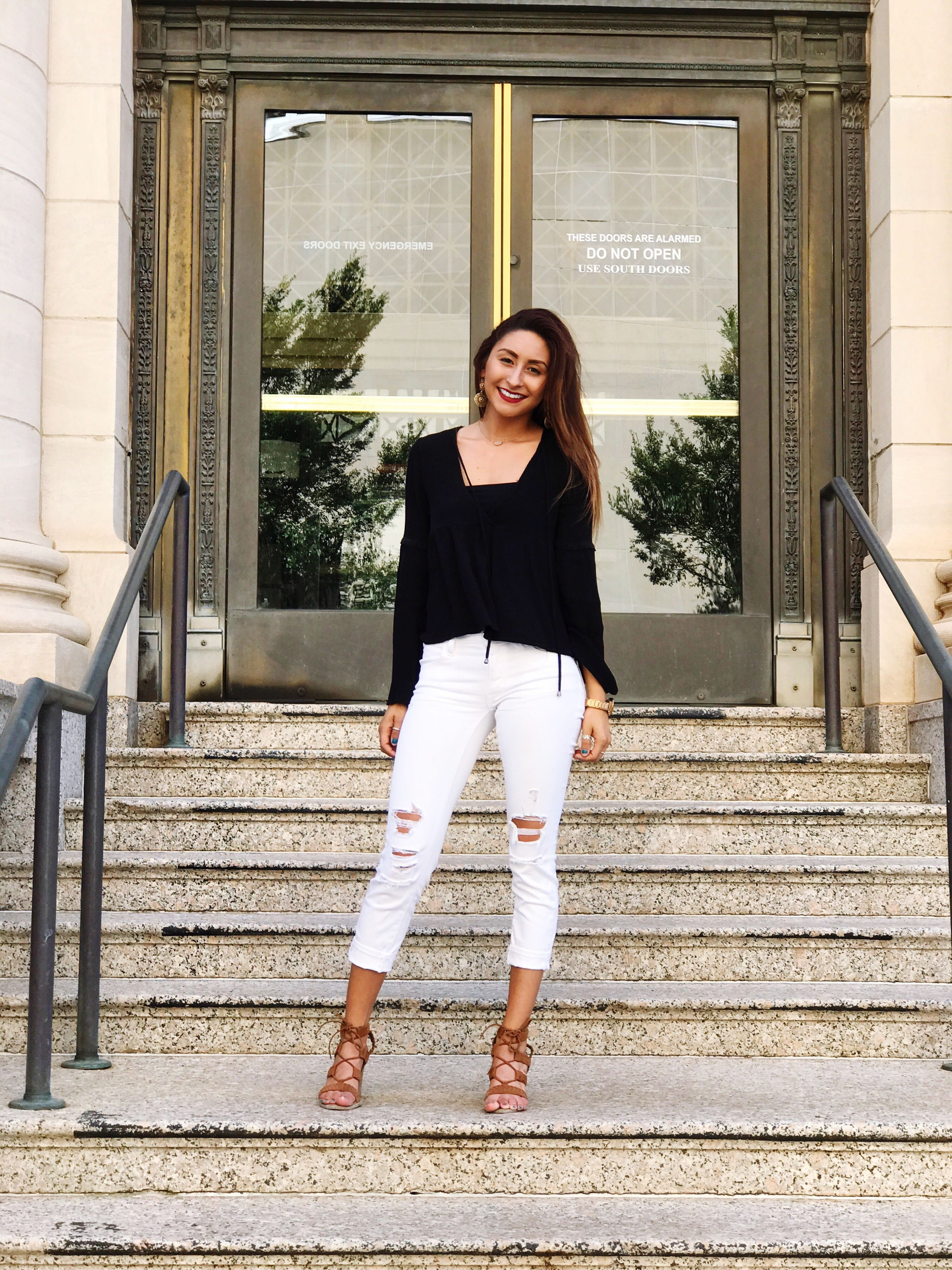 front view, real people, full length, steps, one person, lifestyles, looking at camera, architecture, young adult, young women, portrait, building exterior, built structure, casual clothing, smiling, leisure activity, beautiful woman, outdoors, happiness, walking, standing, day