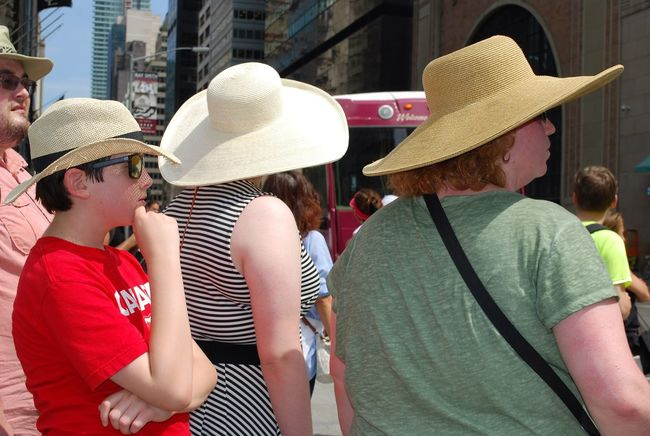 Big Hat Big Hats Casual Clothing City City Life Day Family Friendship Gente Hats Leisure Activity Lifestyles Outdoors Relaxation Sitting Sombrero Sun Protection Sunscreen Vacations