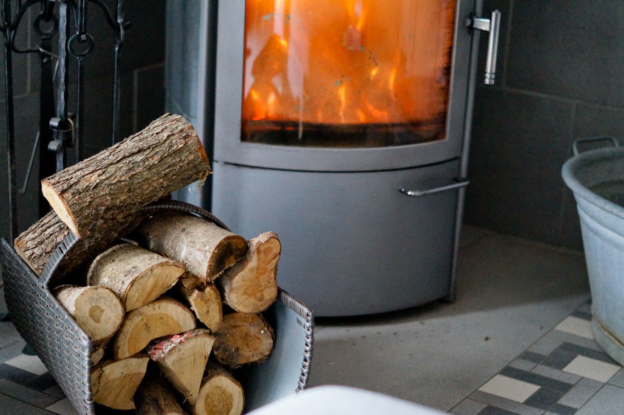 Logs On Container By Wood Burning Stove