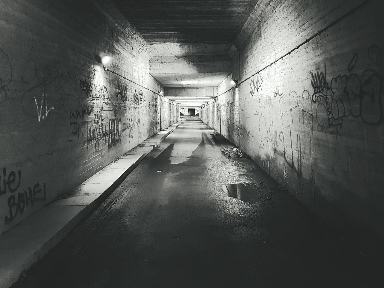 The Way Forward Indoors  Illuminated Tunnel No People Day Graffiti Art Graffiti Wall Underground Underground Walkway Blackandwhite Blackandwhite Photography Tags