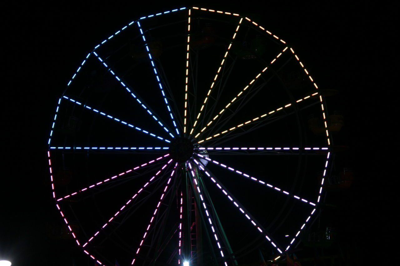 Capital Lakefair 2016 Carnival Carnival Lights Carnival Lights Multi Colored Circle Close-up Fair Fairground Attraction Fairgrounds Ferris Wheel Geometric Shape Glowing Illuminated Low Angle View Multi Colored Night No People Olympia Outdoors Sky Festival Season My Year My View Live For The Story