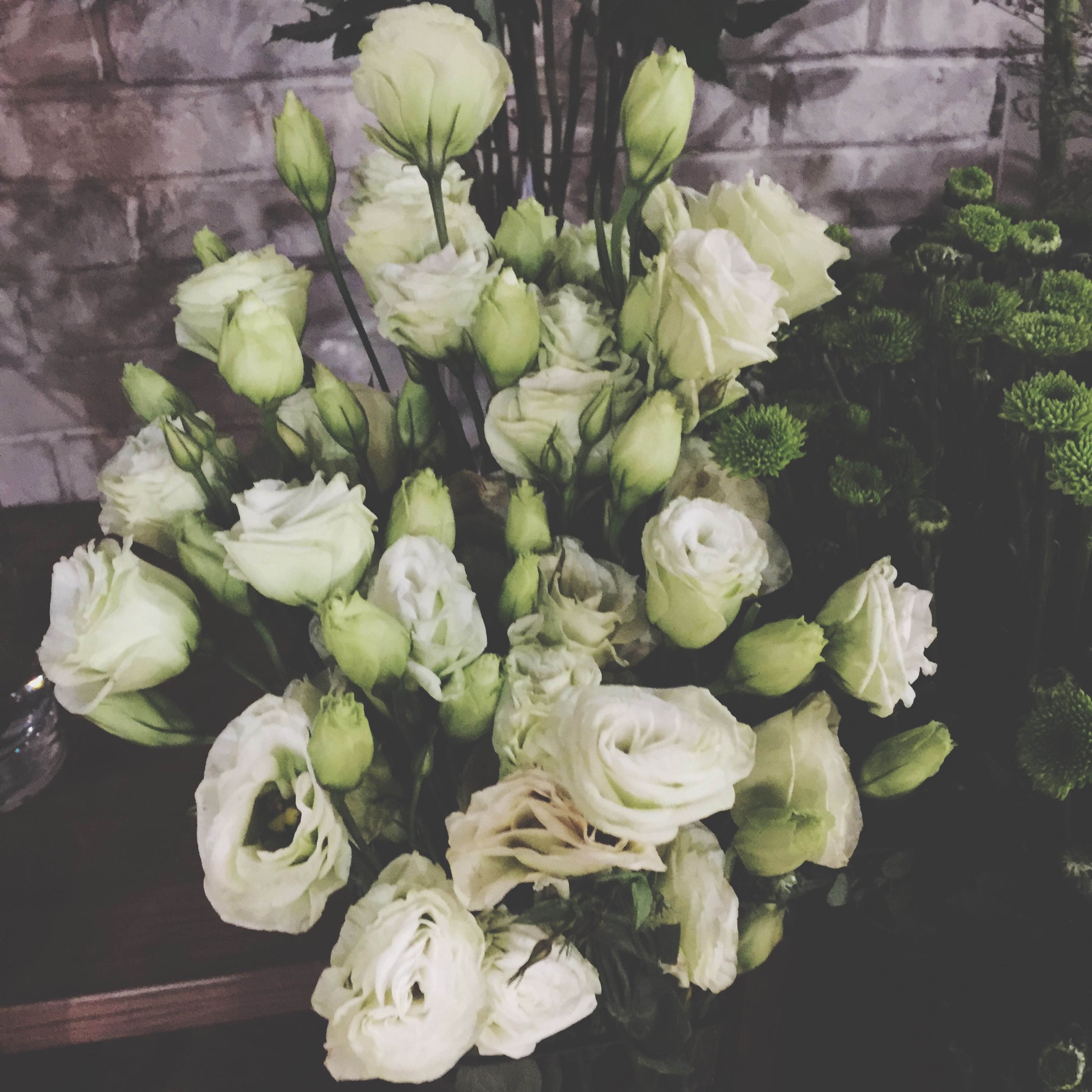 flower, freshness, fragility, growth, petal, plant, leaf, beauty in nature, flower head, high angle view, nature, white color, close-up, green color, bunch of flowers, blooming, rose - flower, bouquet, botany, indoors
