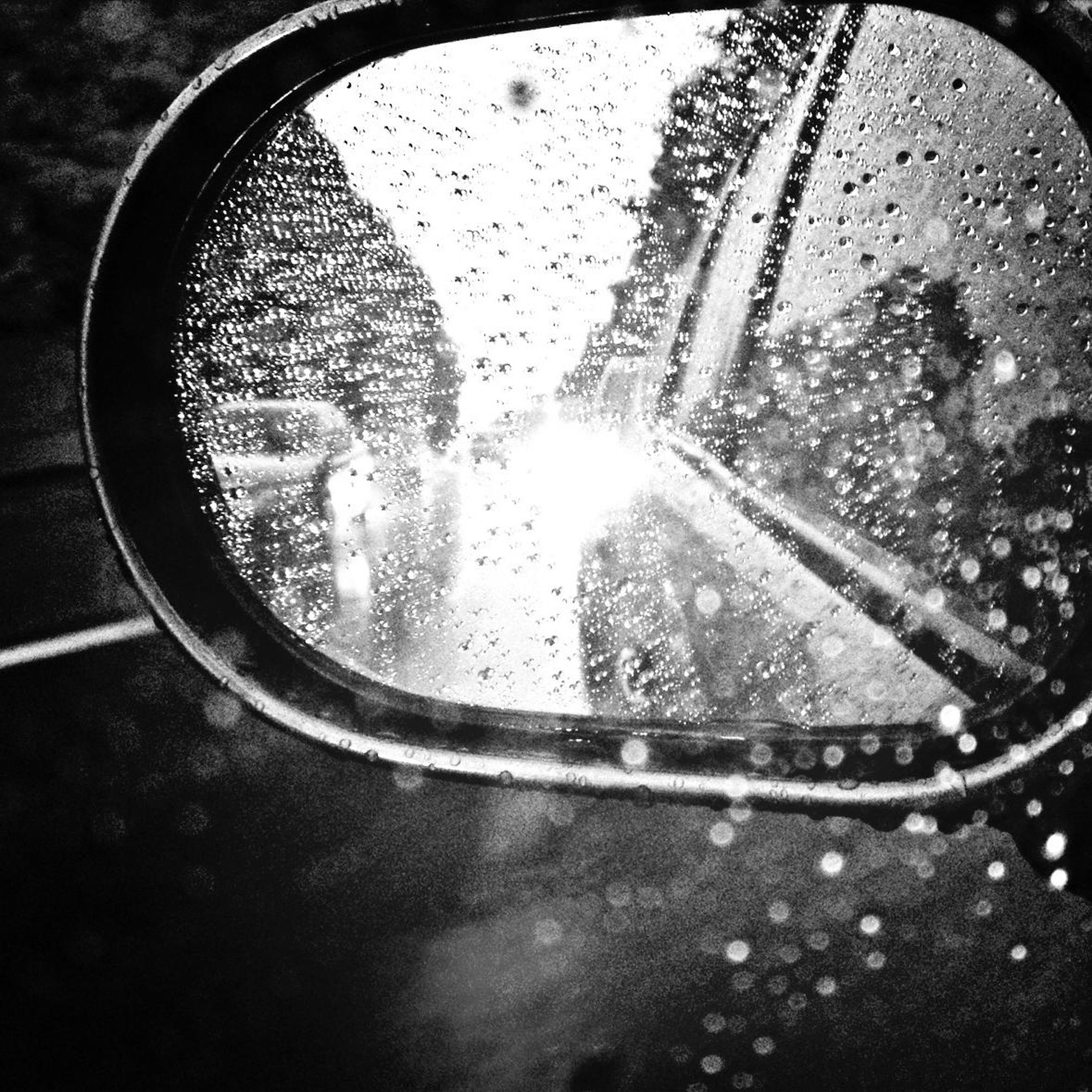 land vehicle, transportation, car, mode of transport, wet, drop, glass - material, reflection, close-up, side-view mirror, transparent, water, rain, street, car interior, window, vehicle interior, part of, raindrop, road
