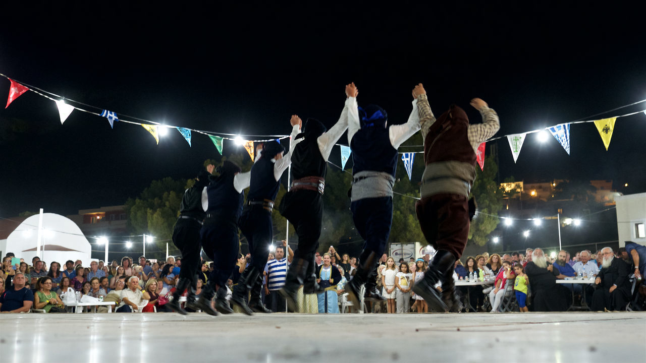 Chruch Crowd Enjoying Event Festival Folk Dance Folk Dancers Fun Greece Greek Greek Dancing Greek Islands Illuminated Large Group Of People Leisure Activity Lifestyles Lindos Night Rhodes Social Gathering Togetherness