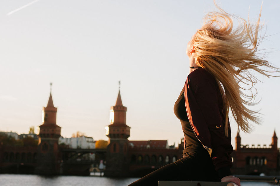 windy Adult Adults Only Architecture Berlin City Clock Tower Cultures Oberbaumbrücke One Person Only Women Outdoors People Sunset Tourist Travel Travel Destinations Urban Skyline Women Young Adult Capture Berlin
