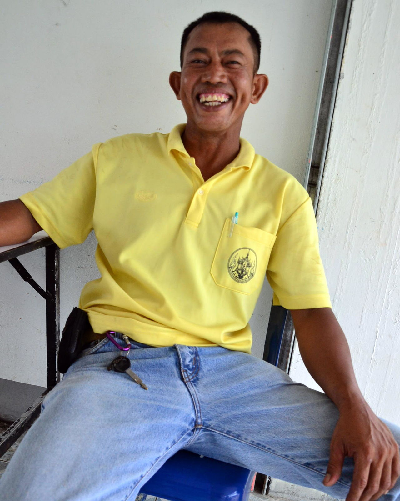 Casual Clothing Day Happiness Indoors  Laughing Laughing Man Laughing Out Loud Looking At Camera Man Laughing One Man Only One Man Only. One Person Portrait Ranong Trip Real People Sitting Smiling Thailand Yellow Young Adult