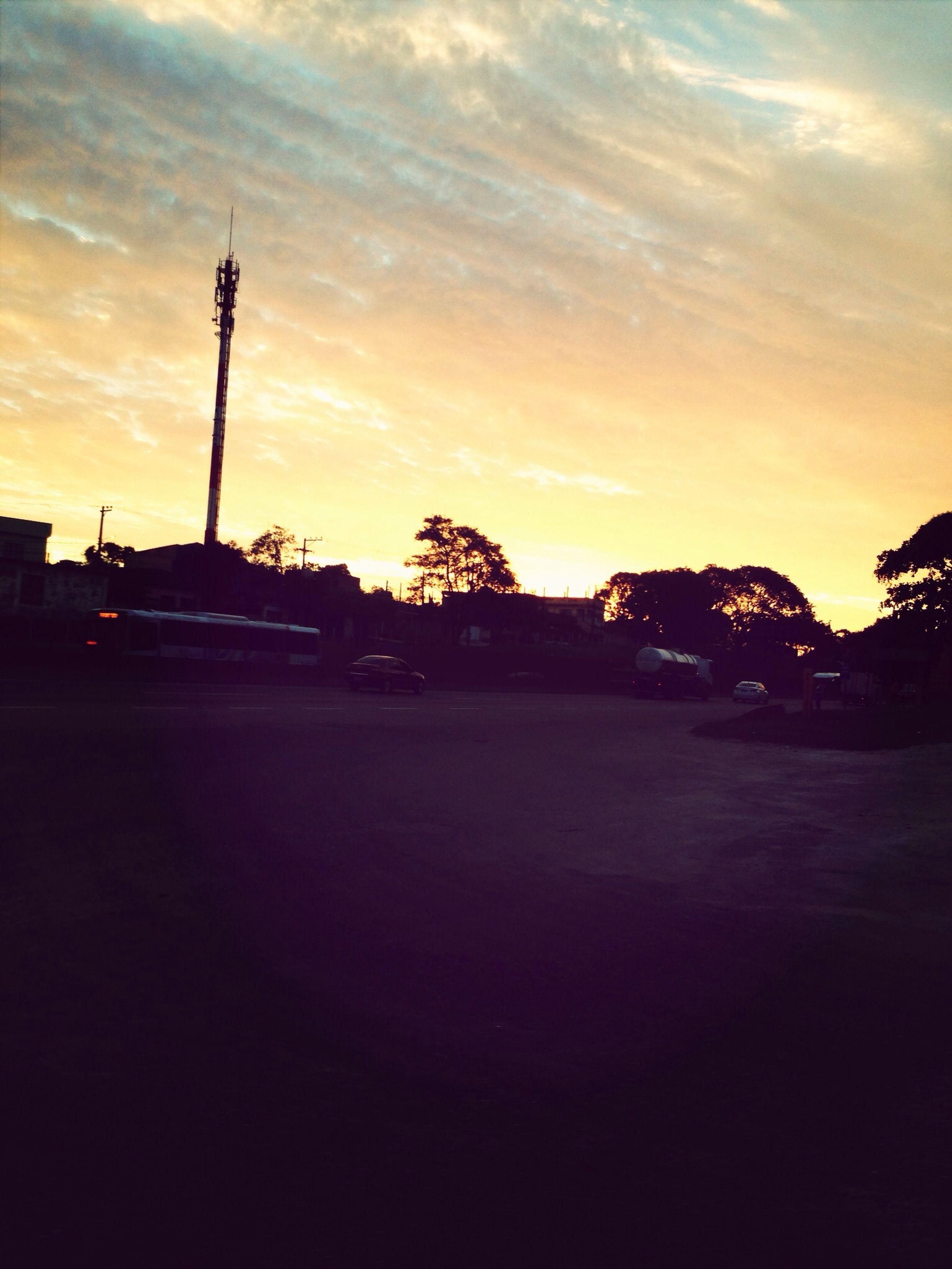 sunset, sky, silhouette, street light, cloud - sky, tree, road, street, building exterior, built structure, dusk, transportation, architecture, orange color, cloud, nature, outdoors, cloudy, car, the way forward