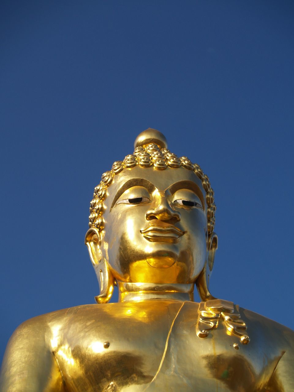 statue, gold colored, religion, sculpture, low angle view, golden color, spirituality, human representation, male likeness, clear sky, idol, copy space, no people, gold, golden, close-up, day