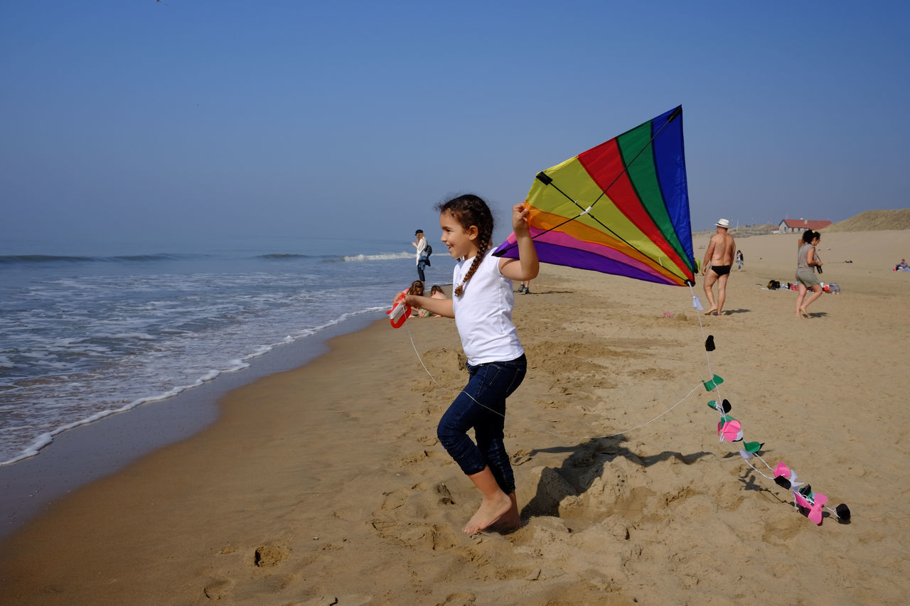 Girl with kite Beach Childhood Clear Sky Day Elementary Age Fun Holland Horizon Over Water Kite Leisure Activity Lifestyles Nature Netherlands One Person Outdoors Play Playing Real People Sand Sea Sky Vacations Water Zandvoort