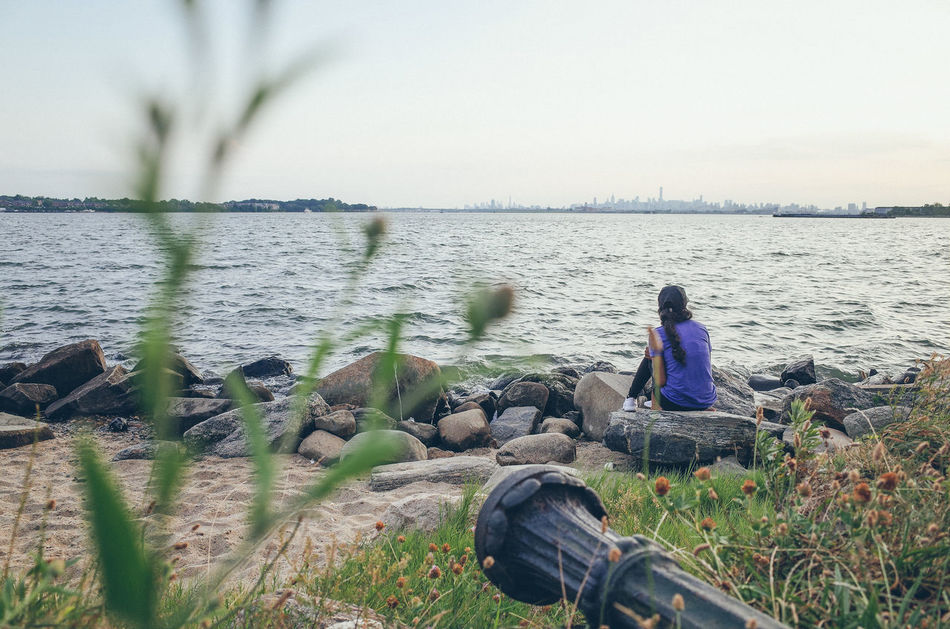 The world seen from behind Backhead Behind Calm Getting Away From It All Horizon New York City Outdoors Rear View Recreational Pursuit Rippled River Sea The World Seen From Behind Water Waterfront