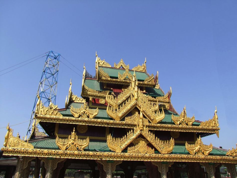Ornate Roof at Yaylel Pagoda Blue Sky Buddhism Buddhist Architecture Buddhist Art Buddhist Culture Buddhist Pagoda Buddhist Temple Building Exterior Composition Gold And Green Colour Low Angle View Myanmar No People Ornate Design Ornate Roof Outdoor Photography Place Of Pilgrimage Place Of Prayer Place Of Worship Religion Spirituality Sunlight Thanlyin Travel Destination Yaylel Pagoda