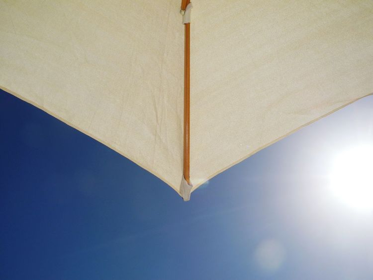 Sun shade. Holiday Trip Hapiness Relax Relaxation Serene Travel Destinations Travel Photography Escape The City Sun Shade Sun Umbrella Shade Shade From Sun Sun Sunshine View From Below Close-up Composition White Umbrella Umbrella Vacationinstyle Vacation Blue Sky Clear Sky In The Shade Sunny Holiday And Relaxing Relaxing No People Relaxing View EyeEmNewHere