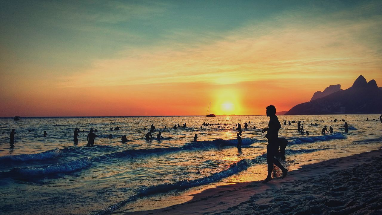 Summertime - 8pm at beach. Sunset Sea Occupation Horizon Over Water Full Length Beach Silhouette Outdoors People Sun Nature Photographer Beauty In Nature Sky Adult One Person Day Brazil Ipanema Beach Ipanema Rio De Janeiro Sunlight Summer
