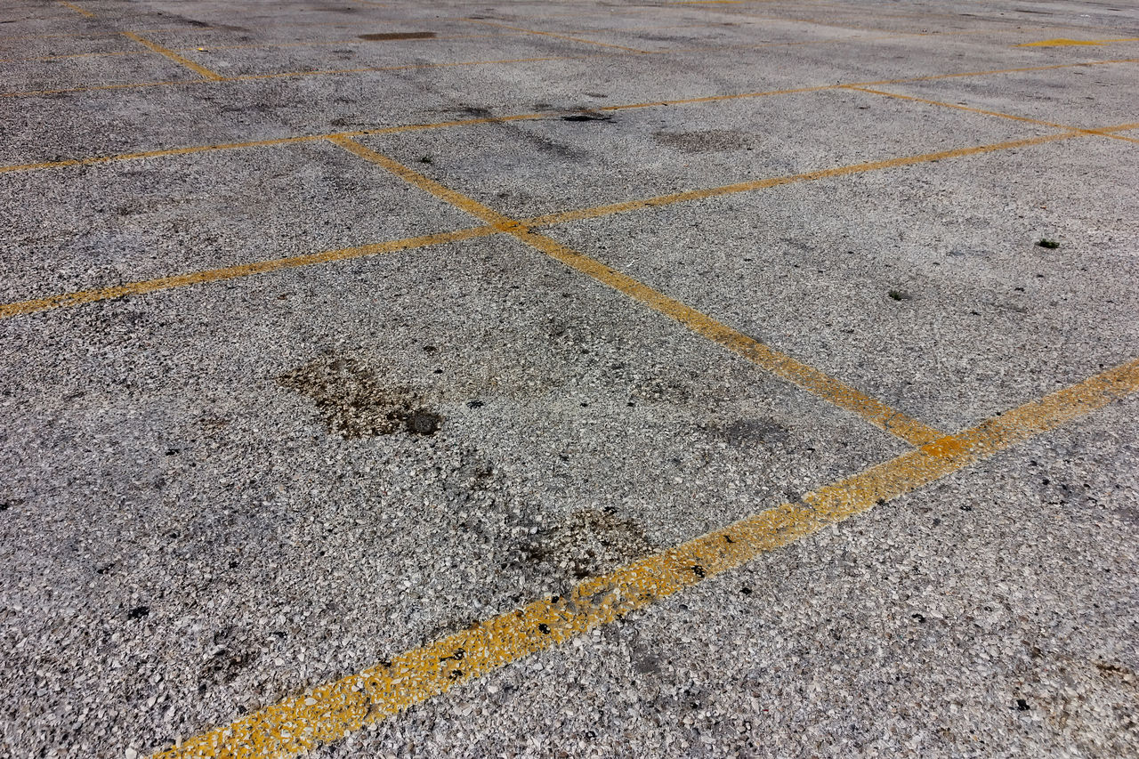yellow lines on dirty bright asphalt Asphalt Backgrounds Close-up Dirty Lines Marking No People Oil Stain Parking Space Road Space Stop Street Texture Textured  Yellow Yellow Stripe