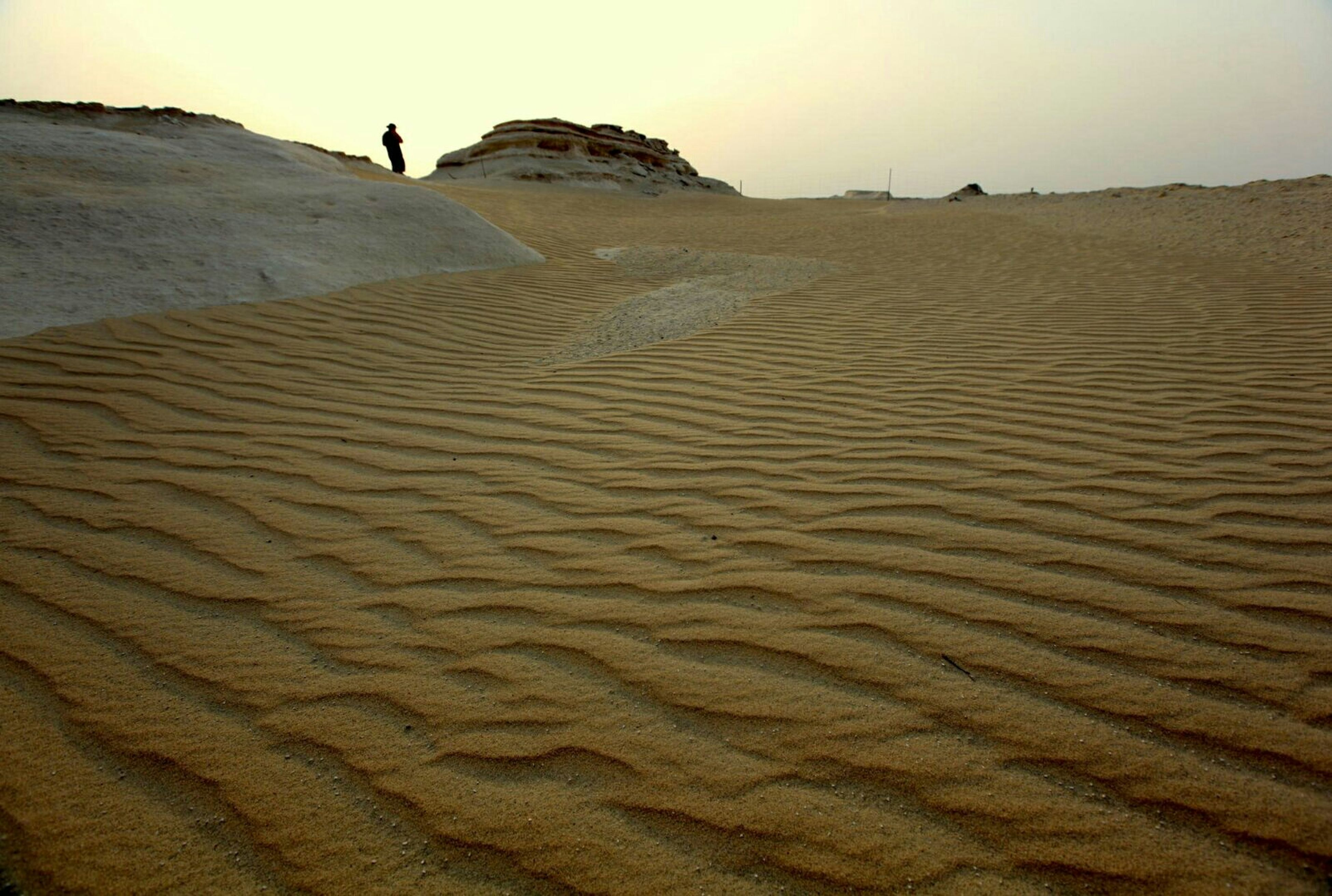 sand, beach, sand dune, tranquility, tranquil scene, desert, arid climate, nature, scenics, beauty in nature, landscape, sky, footprint, remote, vacations, leisure activity, walking, shore